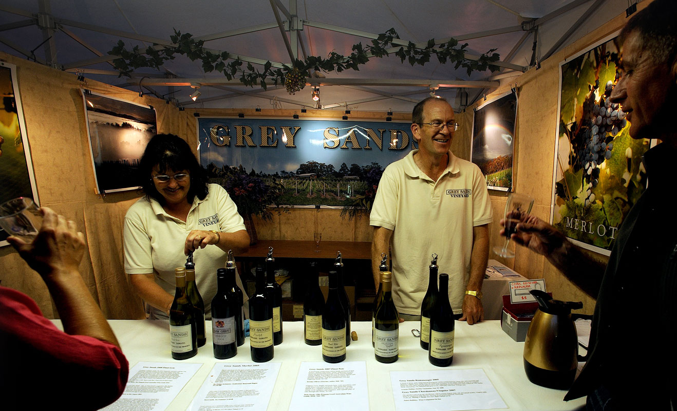 Rita and Bob showing Grey Sands wine