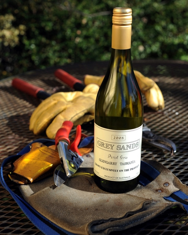 Bottle of Grey Sands 2008 Pinot Gris and vineyard tools