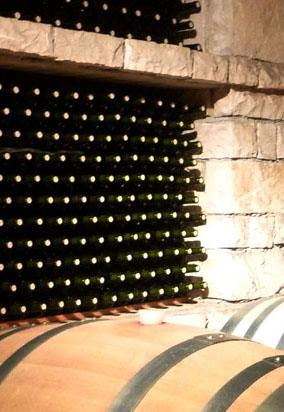 Red wine under cork being cellared