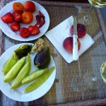 Fresh ripe summer fruits and glasses of wine
